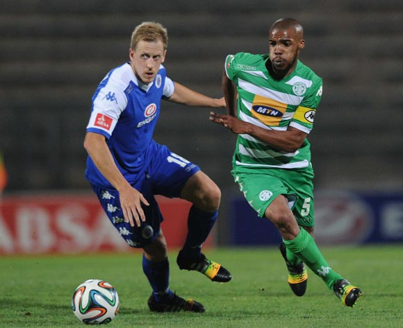 Michael Morton of Supersport United battles with Wandisile Letlabika of Bloemfontein Celtic  during the Absa Premiership match between Supersport United and Bloemfontein Celtic on the 27 September 2014 at Lucas Moripe Wanderers