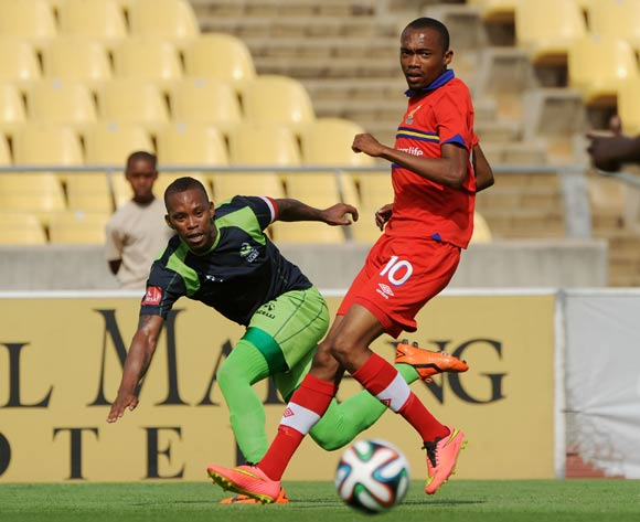 Vuyo Mere of Platinum Stars challenged by Thabo Mnyamane of University of Pretoria during the Absa Premiership 2014/15 match between Platinum Stars and University of Pretoria at Royal Bafokeng Stadium, Rustenburg on 28 September 2014
