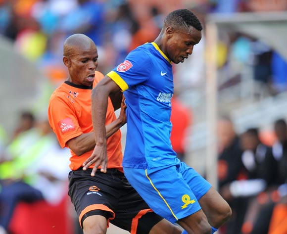 Themba Zwane of Mamelodi Sundowns challenged by Elias Ngwepe of Polokwane City during the Absa Premiership 2014/15 football match between Polokwane City and Mamelodi Sundowns at Peter Mokaba Stadium on the 28 September 2014