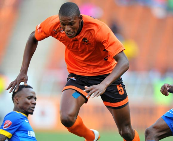 Vukile Mngqibisa of Polokwane City tackled by Teko Modise of Mamelodi Sundowns during the Absa Premiership 2014/15 football match between Polokwane City and Mamelodi Sundowns at Peter Mokaba Stadium on the 28 September 2014