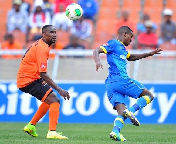 Themba Zwane of Mamelodi Sundowns challenged by Thapelo Tshilo of Polokwane City during the Absa Premiership 2014/15 football match between Polokwane City and Mamelodi Sundowns at Peter Mokaba Stadium on the 28 September 2014