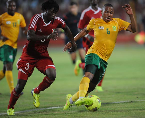 Andile Jali of South Africa battles with Faris Abdallah of Sudan during The African Cup Of Nations Qualifier match between Sudan and South Africa on the 05 September 2014 at El Merreikh stadium