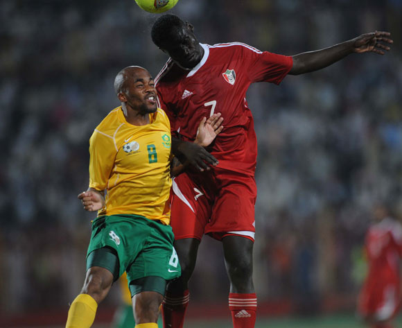 Oupa Manyisa of South Africa battles with Ramdan Agab of Sudan during The African Cup Of Nations Qualifier match between Sudan and South Africa on the 05 September 2014 at El Merreikh stadium