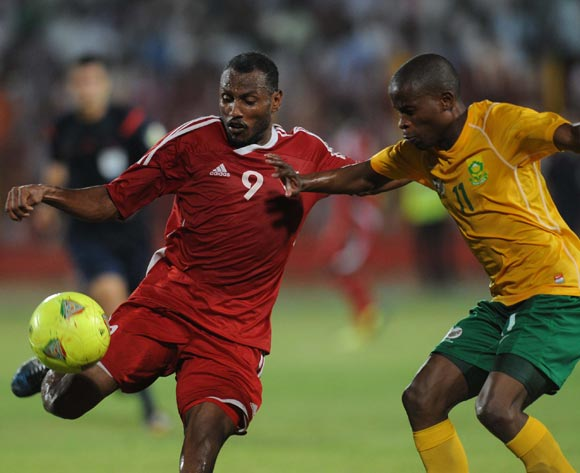 Thabo Matlaba of South Africa battles with Bakri Abdelgradir of Sudan during The African Cup Of Nations Qualifier match between Sudan and South Africa on the 05 September 2014 at El Merreikh stadium