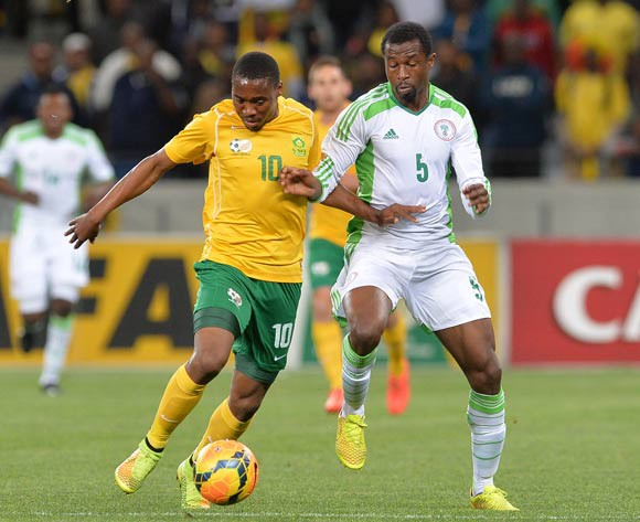 Sibusiso Vilakazi of South Africa battles for the ball with Efe Ambrose of Nigeria