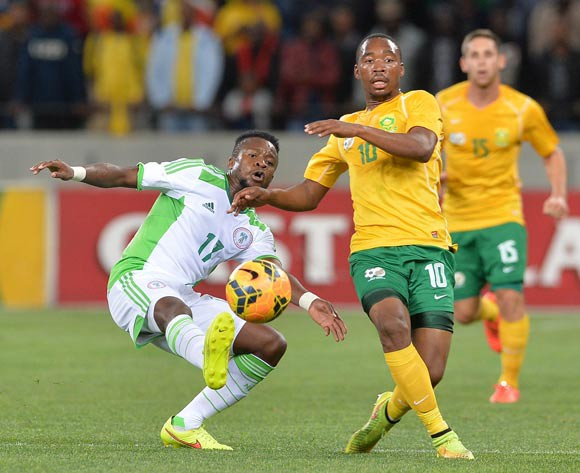 Sibusiso Vilakazi of South Africa battles for the ball with Ogenyi Onazi of Nigeria on Wednesday.
