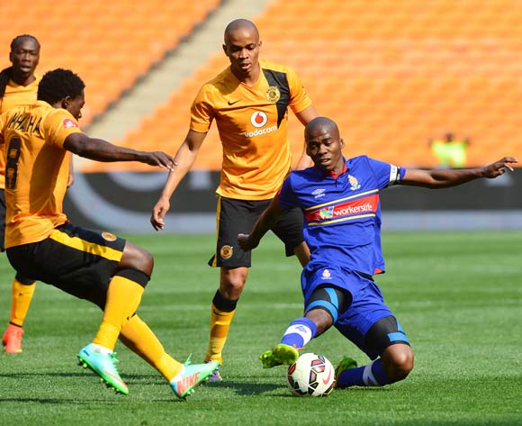 Mpho Matsi of University of Pretoria clears from Kingston Nkhatha and Siyabonga Nkosi of Kaizer Chiefs during the 2014/15 Absa Premiership football match between Kaizer Chiefs and University of Pretoria at Soccer City, Johannesburg on 13 September 2014