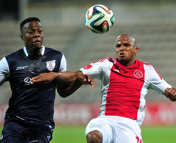 Cecil Lolo of Ajax Cape Town gets to the ball ahead of Themba Shabalala of Free State Stars during the Absa Premiership 2014/15 game between Ajax Cape Town and Free State Stars at Athlone Stadium, Cape Town on 13 September 2014