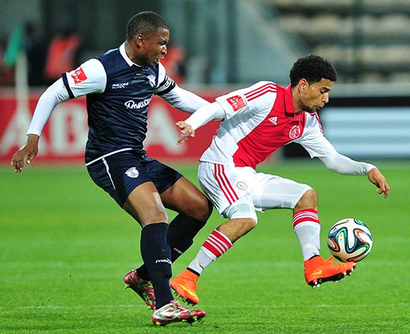 Keagan Dolly of Ajax Cape Town controls the ball ahead of Paulus Masehe of Free State Stars during the Absa Premiership 2014/15 game between Ajax Cape Town and Free State Stars at Athlone Stadium, Cape Town on 13 September 2014