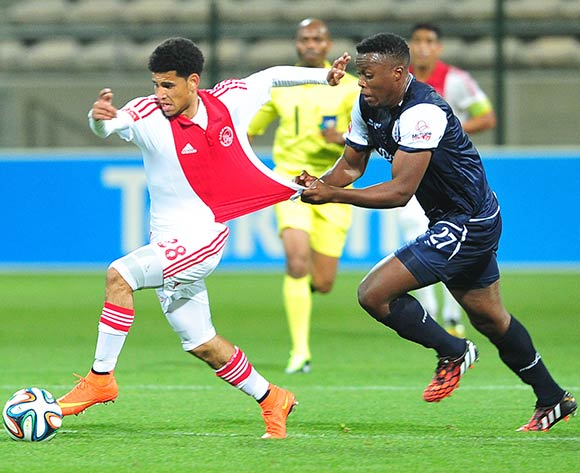 Themba Shabalala of Free State Stars pulls on the jersey of Keagan Dolly of Ajax Cape Town during the Absa Premiership 2014/15 game between Ajax Cape Town and Free State Stars at Athlone Stadium, Cape Town on 13 September 2014