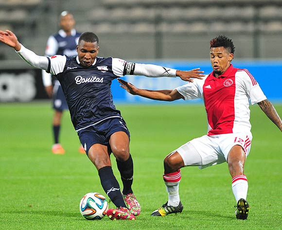 Paulus Masehe of Free State Stars holds off Granwald Scott of Ajax Cape Town during the Absa Premiership 2014/15 game between Ajax Cape Town and Free State Stars at Athlone Stadium, Cape Town on 13 September 2014