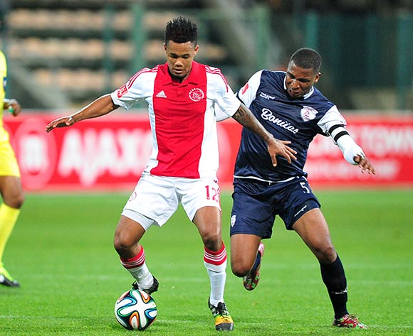 Granwald Scott of Ajax Cape Town and Paulus Masehe of Free State Stars battle for possession during the Absa Premiership 2014/15 game between Ajax Cape Town and Free State Stars at Athlone Stadium, Cape Town on 13 September 2014