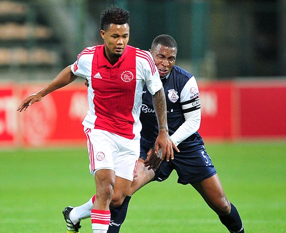 Granwald Scott of Ajax Cape Town on the ball ahead of Paulus Masehe of Free State Stars during the Absa Premiership 2014/15 game between Ajax Cape Town and Free State Stars at Athlone Stadium, Cape Town on 13 September 2014