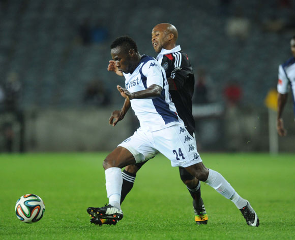 Onismor Bhasera of Bidvest Wits battles with Oupa Manyisa of Orlando Pirates during The Absa Premiership match between Orlando Pirates and Bidvest Wits on the 13 September 2014 at Orlando Stadium