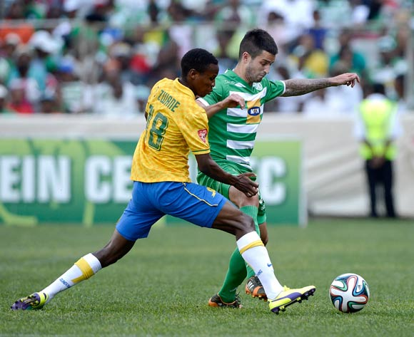 Themba Zwane of Mamelodi Sundowns and Keegan Ritchie of Bloemfontein Celtic during the Absa Premiership match between Bloemfontein Celtic FC and Mamelodi Sundowns FC at the Free State Stadium on 14 September 2014