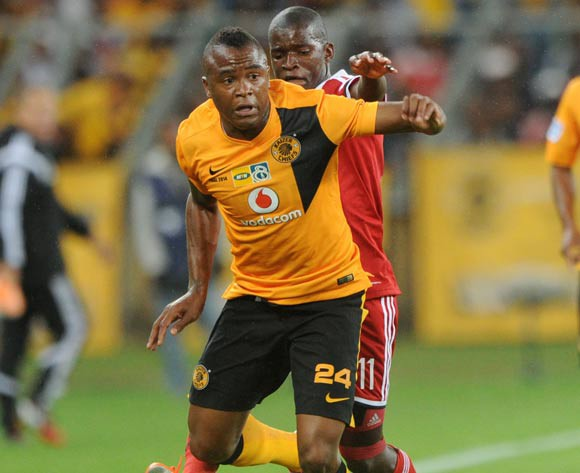 Tsepo Masilela of Kaizer Chiefs challenged by Sifiso Myeni of Orlando Pirates during the 2014 MTN 8 Final match between Orlando Pirates and Kaizer Chiefs at Moses Mabhida Stadium,  Durban on the 20 September 2014