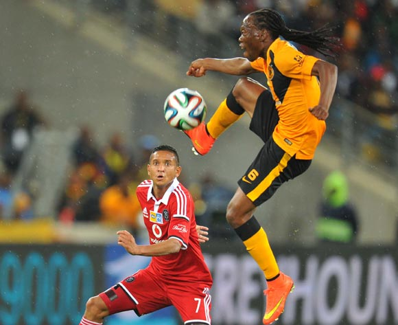 Reneilwe Letsholonyane of Kaizer Chiefs challenged by Daine Klate of Orlando Pirates during the 2014 MTN 8 Final match between Orlando Pirates and Kaizer Chiefs at Moses Mabhida Stadium on the 20 September 2014