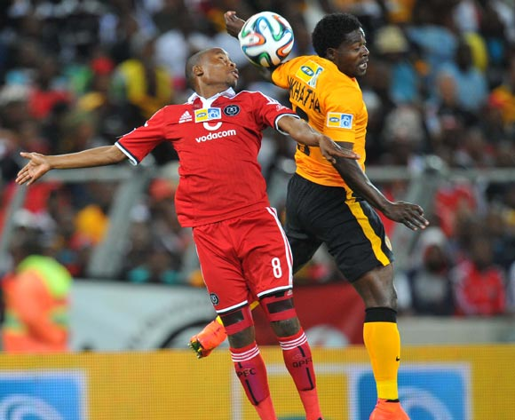 Thabo Matlaba of Orlando Pirates challenged by Kingston Nkhatha of Kaizer Chiefs during the 2014 MTN 8 Final match between Orlando Pirates and Kaizer Chiefs at Moses Mabhida Stadium on the 20 September 2014