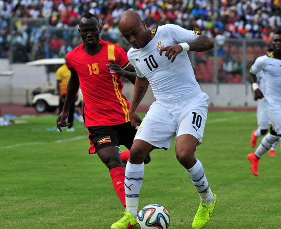 Walusimbi Godfrey of Uganda challenging Andre Ayew of Ghana at the Afcon Qualifiers