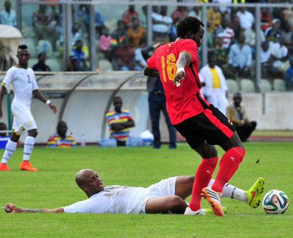 Andre Ayew of Ghana challenging Kabugo Savio of Uganda at the Afcon Qualifiers