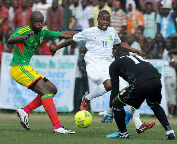 Thabo Matlaba of South Africa challenged by Igor Nganga of Congo during the African Cup of Nations Qualifiers match between Congo and South Africa at Stade Municipal de Pointe-Noire Stadium, Congo Brazzaville on 11 October 2014