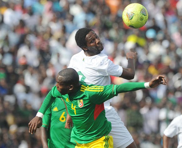 Bongani Ndulula of South Africa battles with Ngounga Boris of Congo during the African Cup of Nations Qualifiers match between Congo and South Africa at Stade Municipal de Pointe-Noire Stadium, Congo Brazzaville on 11 October 2014