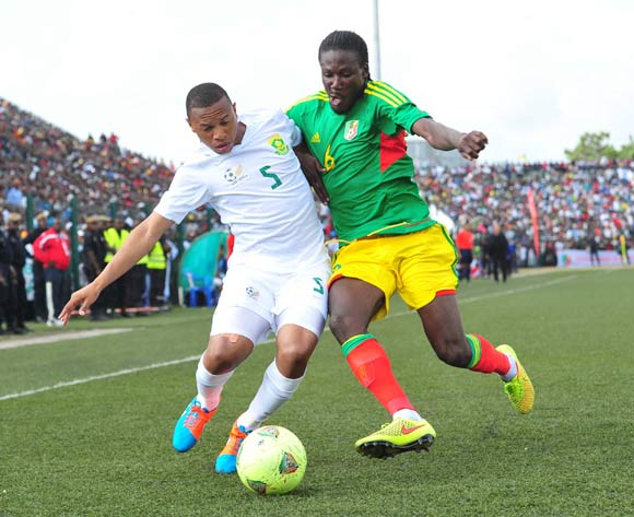 Andile Jali of South Africa battles with Bissiki Davy of Congo during the African Cup of Nations Qualifiers match between Congo and South Africa at Stade Municipal de Pointe-Noire Stadium, Congo Brazzaville on 11 October 2014