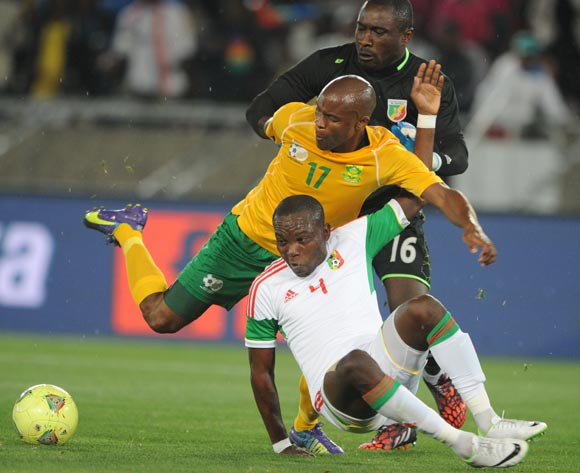 Tokelo Rantie of South Africa battles with Moubhio Boris and Mohikola Chansel of Congo during the 2015 African Cup of Nations Qualifier match between South Africa and Congo, at Peter Mokaba Stadium on 14 October 2014