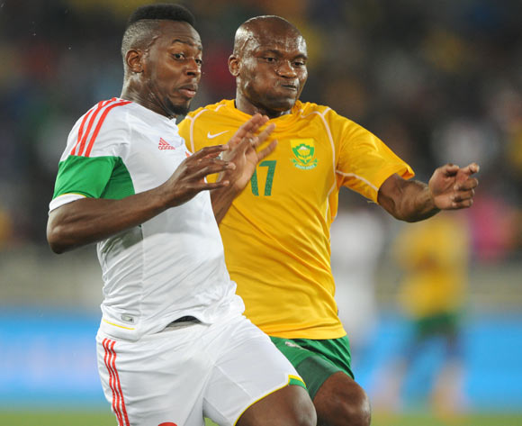 Tokelo Rantie of South Africa battles with Francis N Ganga of Congo during the 2015 African Cup of Nations Qualifier match between South Africa and Congo, at Peter Mokaba Stadium on 14 October 2014