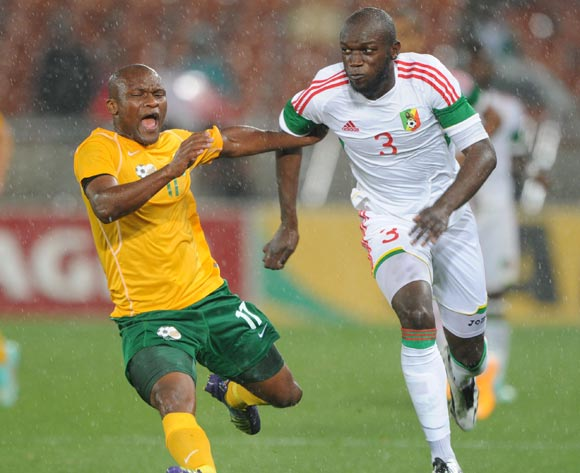 Tokelo Rantie of South Africa fouled by Igori Nganga of Congo during the 2015 African Cup of Nations Qualifier match between South Africa and Congo, at Peter Mokaba Stadium on 14 October 2014