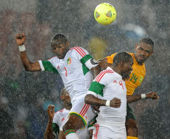 Thulani Hlatshwayo of South Africa battles with Oniangue Prince and Moubhio Boris of Congo during the 2015 African Cup of Nations Qualifier match between South Africa and Congo, at Peter Mokaba Stadium on 14 October 2014