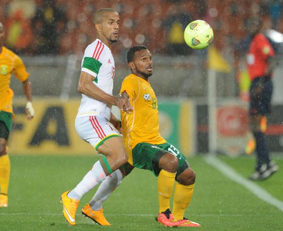 Kermit Erasmus of South Africa battles with Tony Marvin of Congo during the 2015 African Cup of Nations Qualifier match between South Africa and Congo, at Peter Mokaba Stadium on 14 October 2014