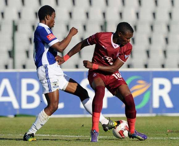 Vuyisile Wana of Moroka Swallows challenged by Abia Nale of Black Aces during the Absa Premiership 2014/15  match between Moroka Swallows and Black Aces at Dobsonville Stadium, Soweto on 18 October 2014