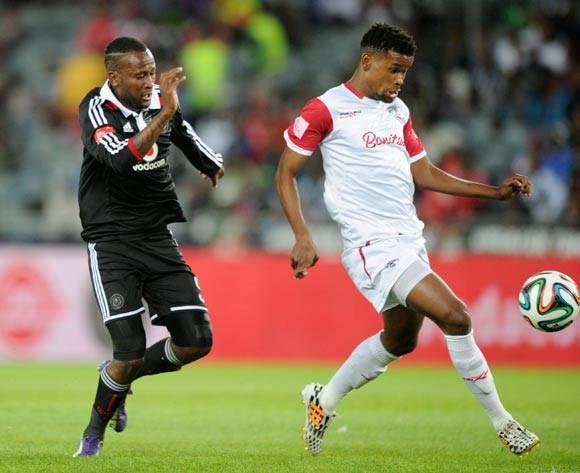 Bokang Tlhone of Free State Stars challenged by Mpho Makola of Orlando Pirates  during the Absa Premiership 2014/15  match between Orlando Pirates and Free State Stars at Orlando Stadium, Soweto on 18 October 2014