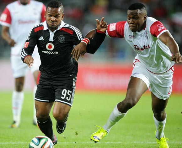 Kermit Erasmus of Orlando Pirates challenged by Themba Shabalala of Free State Stars during the Absa Premiership 2014/15  match between Orlando Pirates and Free State Stars at Orlando Stadium, Soweto on 18 October 2014