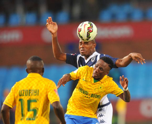 Teko Modise of Mamelodi Sundowns challenged by Thulani Hlatshwayo of Bidvest Wits during the Absa Premiership 2014/15 football match between Mamelodi Sundowns and Bidvest Wits at Loftus Stadium on the 18 October 2014