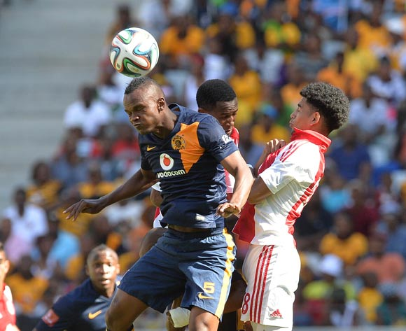 Keagan Dolly of Ajax Cape Town battles for the ball with Siboniso Gaxa of Kaizer Chiefs during the Absa Premiership 2014/15 football match between Ajax Cape Town and Kaizer Chiefs at Cape Town Stadium, Cape Town on 19 October 2014