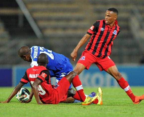 Lebogang Manyama of Supersport United challenged by Ntuthuko Mabaso and Nhlanhla Vilakazi of Maritzburg United during the Absa Premiership 2014/15 football match between Supersport United and Maritzburg United at Lucas Moripe Stadium on the 22 October 2014