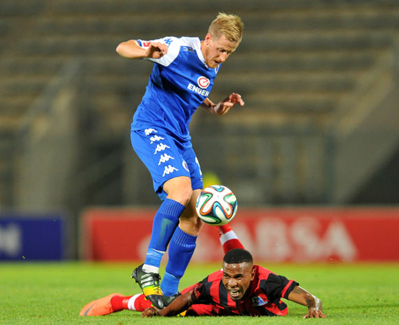 Michael Morton of Supersport United challenged by Nhlanhla Vilakazi of Maritzburg United during the Absa Premiership 2014/15 football match between Supersport United and Maritzburg United at Lucas Moripe Stadium on the 22 October 2014