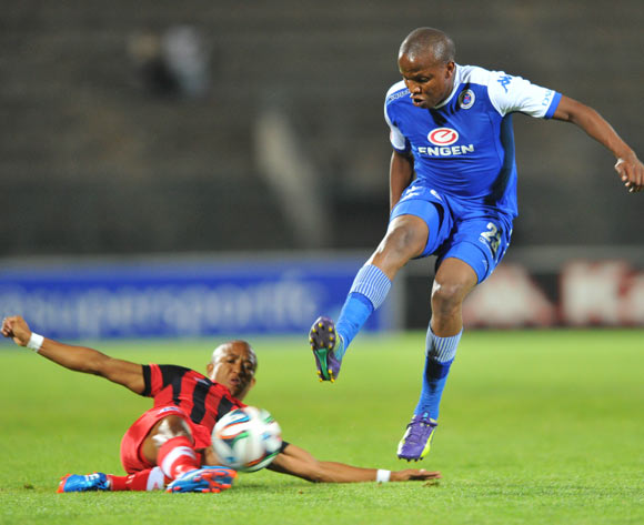 Lebogang Manyama of Supersport United challenged by Kurt Lentjies of Maritzburg United during the Absa Premiership 2014/15 football match between Supersport United and Maritzburg United at Lucas Moripe Stadium on the 22 October 2014