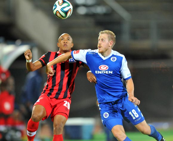 Michael Morton of Supersport United challenged by Kurt Lentjies of Maritzburg United during the Absa Premiership 2014/15 football match between Supersport United and Maritzburg United at Lucas Moripe Stadium on the 22 October 2014