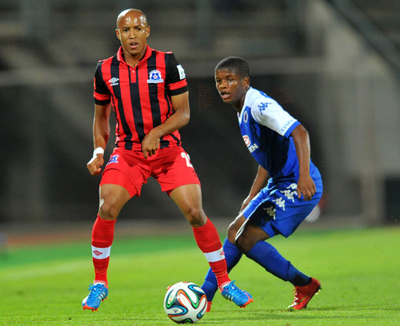 Thabo Moloi of Supersport United challenged by Kurt Lentjies of Maritzburg United during the Absa Premiership 2014/15 football match between Supersport United and Maritzburg United at Lucas Moripe Stadium on the 22 October 2014