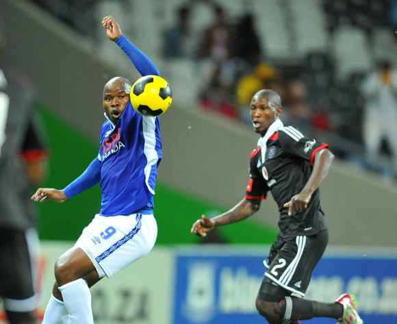 Collins Mbesuma of Black Aces challenged by Ayanda Gcaba of Orlando Pirates during the Absa Premiership 2014/15 football match between Black Aces and Orlando Pirates at Mbombela Stadium on the 21 October 2014