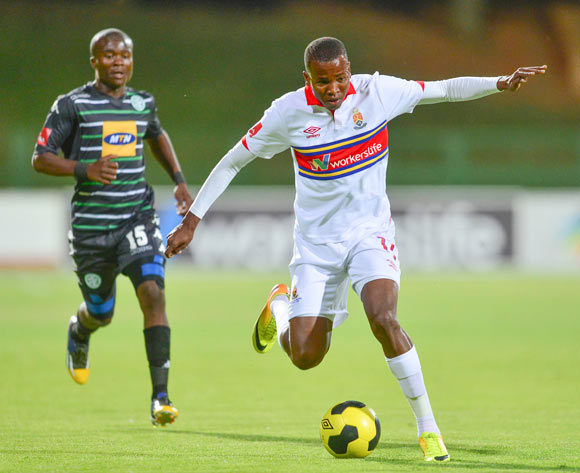 Vuyani Ntanga of Bloemfontein Celtic and Thabo Mosadi of University of Pretoria during the Absa Premiership Football match between University of Pretoria and Bloemfontein Celtic at LC de Villiers Stadium at Tuks in Pretoria on October 22, 2014