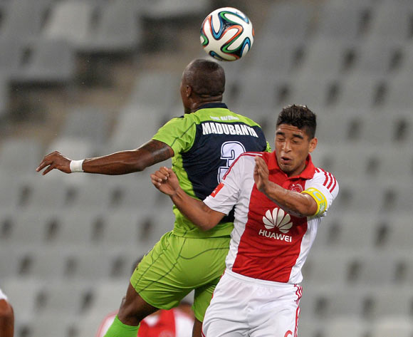 Travis Graham of Ajax Cape Town battles for the ball with  Letladi Madubanya of Platinum Stars during the Absa Premiership 2014/15 football match between Ajax Cape Town and Platinum Stars at Cape Town Stadium, Cape Town on 22 October 2014