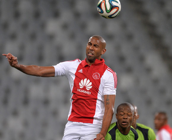 Nathan Paulse of Ajax Cape Town battles for the ball with Ndumiso Mabena of Platinum Stars during the Absa Premiership 2014/15 football match between Ajax Cape Town and Platinum Stars at Cape Town Stadium, Cape Town on 22 October 2014