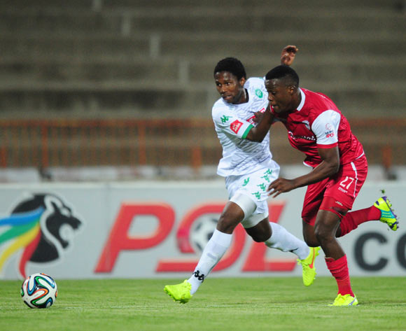 Bongani Ndulula of AmaZulu battles Themba Shabalala of Free State Stars during the Absa Premiership 2014/15 football match between Free State Stars and AmaZulu at the Charles Mopeli Stadium in Qwa-Qwa , Free State Province on the 22nd of October 2014