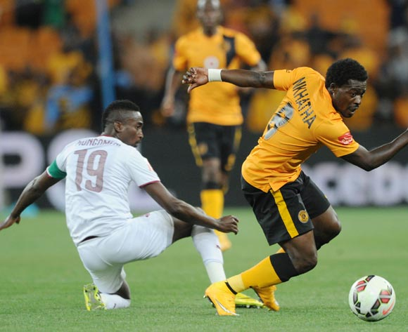 Kingston Nkhatha of Kaizer Chiefs challenged by Luvhengo Mungomeni of Moroka Swallows during the Absa Premiership 2014/15 match between Kaizer Chiefs and Moroka Swallows at FNB Stadium, Johannesburg on 22 October 2014