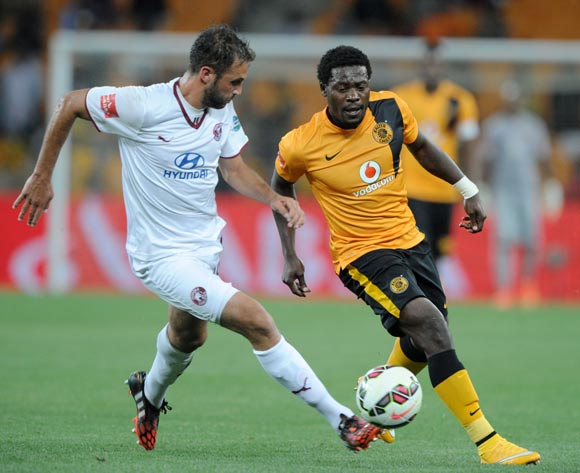 Kingston Nkhatha of Kaizer Chiefs challenged by Larry Cohen of Moroka Swallows during the Absa Premiership 2014/15 match between Kaizer Chiefs and Moroka Swallows at FNB Stadium, Johannesburg on 22 October 2014