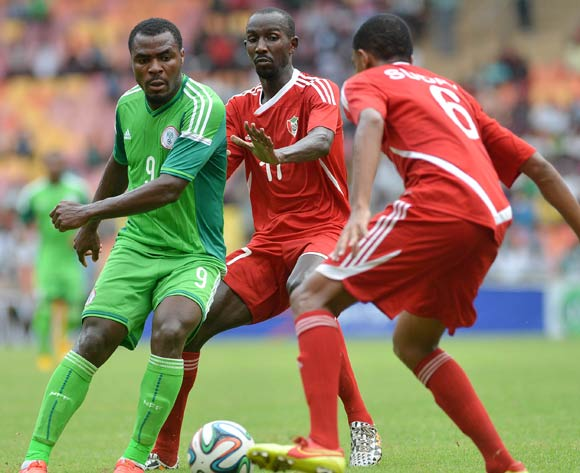 Emmanuel Eminike of Nigeria challenged by Nasr El Dinomer and Ali Gafar of Sudan during the 2015 African Nations Cup qualifying  Match between Nigeria and Sudan on 15th October, 2014 National Stadium Abuja, Nigeria